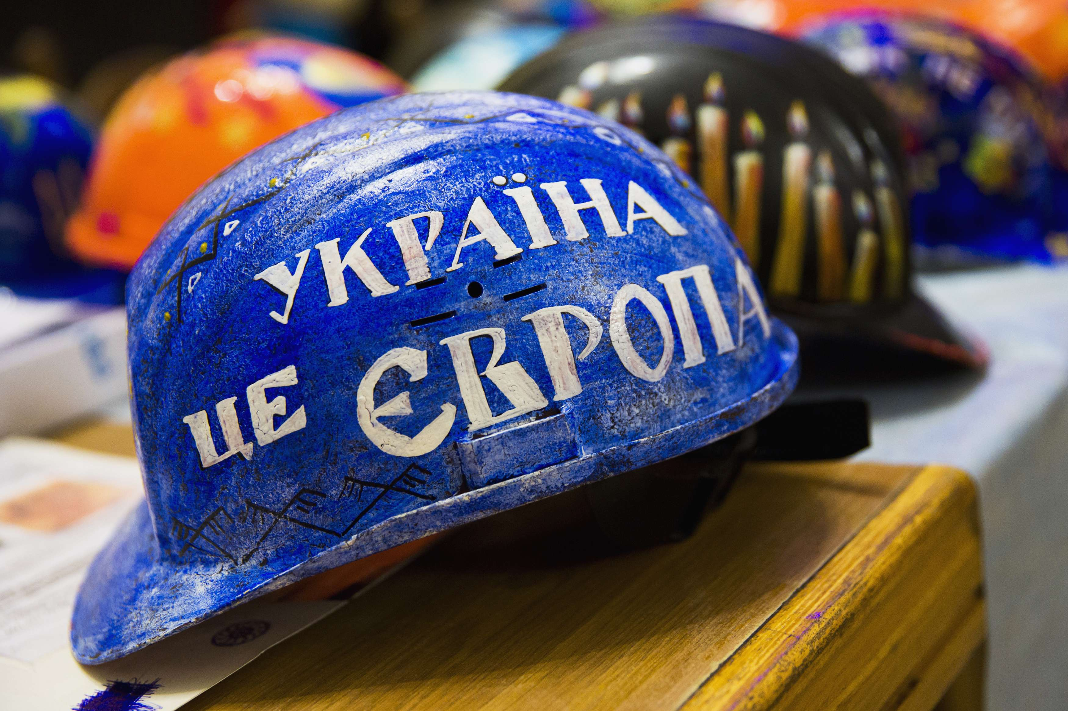 A hardhat for anti-government protester painted with words 'Ukraine is Europe', on display at Kiev City Hall